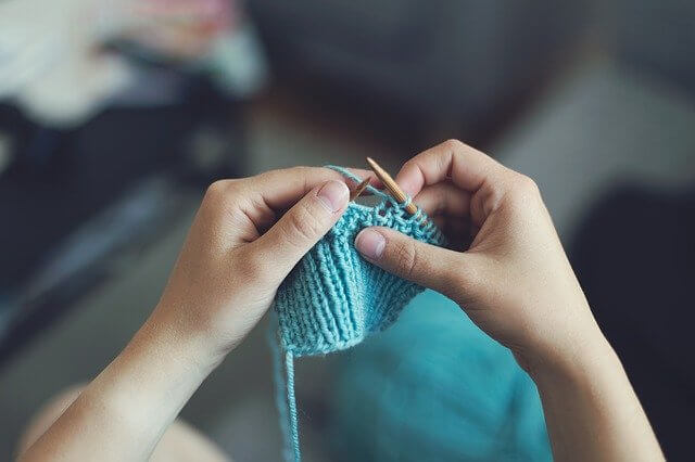 Knitting a blue sweater